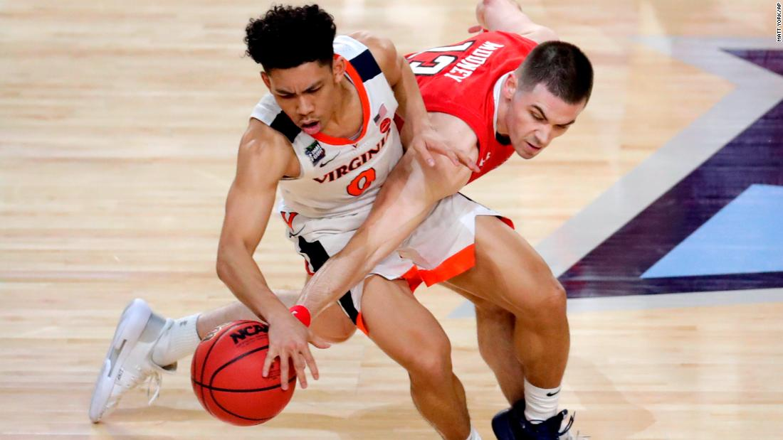 Mooney tries to steal the ball from Virginia's Kihei Clark during the second half.