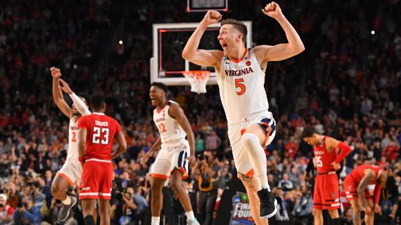 Kyle Guy, foreground, and the Virginia Cavaliers celebrate after winning the NCAA tournament final on Monday, April 8.