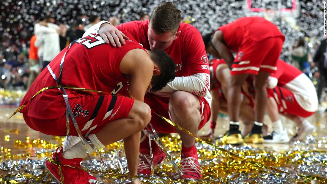 Texas Tech point guard Davide Moretti, left, is consoled by a teammate after the game.