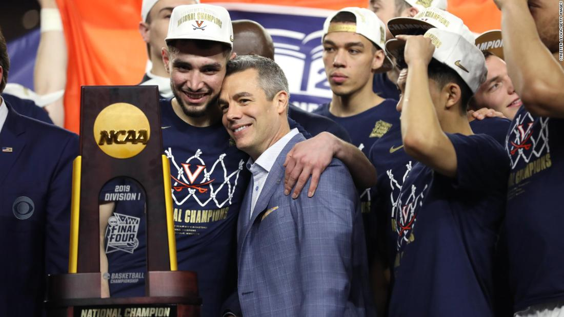 Virginia head coach Tony Bennett rests his head on point guard Ty Jerome during the trophy presentation.
