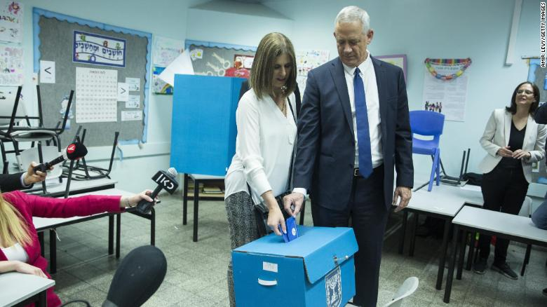 Benny Gantz and his wife, Revital, cast thier ballot at a polling station in Rosh Ha'ayin.