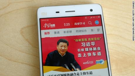 "This photo illustratration from February shows a phone app called ""Xuexi Qiangguo"" or ""Study to make China strong"" with an image of China's President Xi Jinping in Beijing."