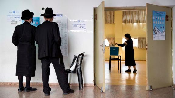 An ultra-Orthodox Jewish woman votes for Israel's parliamentary election at a polling station in Bnei Brak, Israel, Tuesday, April 9, 2019. (AP Photo/Oded Balilty)