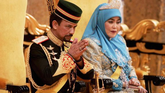 Sultan of Brunei Hassanal Bolkiah and his wife during a ceremony at Istana Palace in Bandar Seri Begawan, Brunei Darussalam on July 15, 2005.