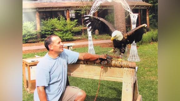 Robert Vallieres shows a bald eagle to a group in New Hampshire. The disabled Gulf War veteran has been tracking and rehabilitating birds for nearly 25 years.