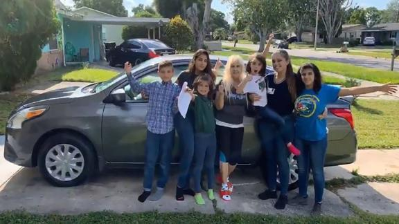 Samantha Rodriguez, second from right, and her family pose in front of her new car.