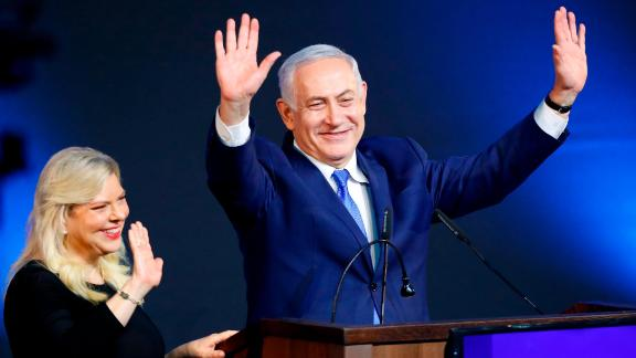 Israeli Prime Minister Benjamin Netanyahu greets supporters with his wife Sara at his Likud Party headquarters in the Israeli coastal city of Tel Aviv on election night early on April 10, 2019. (Photo by Jack GUEZ / AFP)        (Photo credit should read JACK GUEZ/AFP/Getty Images)