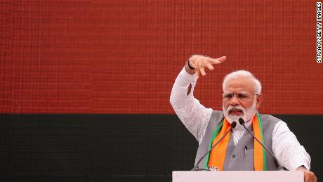 Indian Prime Minister Narendra Modi gestures at an event to present the Bharatiya Janata Party (BJP) election manifesto in New Delhi on April 8, 2019. - Indian Prime Minister Narendra Modi on April 8 sought to woo Hindu voters and farmers with an election manifesto he hopes will help him seal a second term in office. (Photo by STR / AFP)        (Photo credit should read STR/AFP/Getty Images)