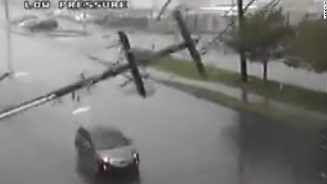 Video captures moment utility pole crashes through car