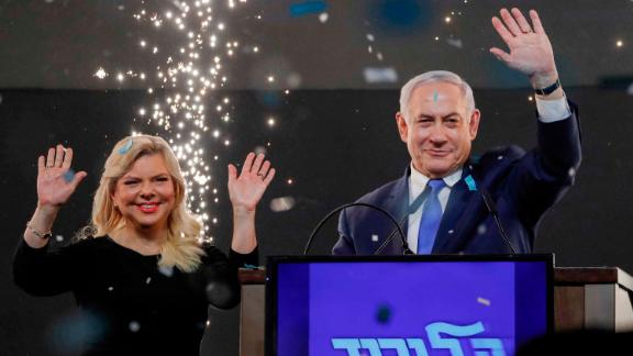 Benjamin Netanyahu, accompanied by his wife Sara, celebrates with supporters at his Likud Party HQ in Tel Aviv on election night.