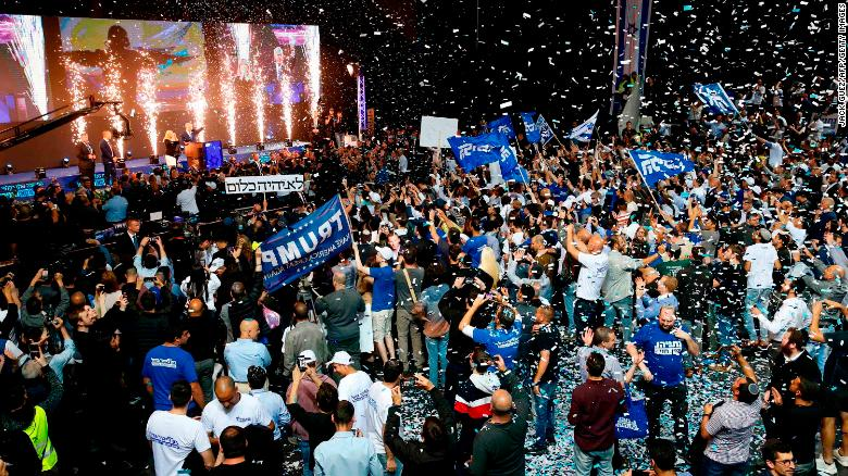 Likud supporters celebrate as Prime Minister Benjamin Netanyahu waves to them at its headquarters in Tel Aviv.