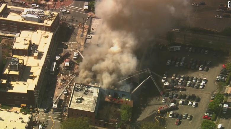 Firefighters respond to the gas blast in Durham on Wednesday morning.