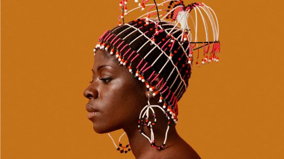 Kwame Brathwaite, Sikolo Brathwaite wearing a headpiece designed by Carolee Prince, African Jazz-Art Society & Studios (AJASS), Harlem, ca. 1968; from Kwame Brathwaite: Black Is Beautiful (Aperture, 2019)