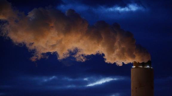 Emissions rise from the coal fired Santee Cooper Cross Generating Station power plant at dusk in Pineville, South Carolina, U.S., on Wednesday, March 21, 2018. Construction of new coal plants around the world fell for the second year in a row in 2017 as the world's biggest polluters began to restrict new projects and explore other technologies. Photographer: Luke Sharrett/Bloomberg via Getty Images