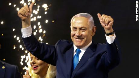 Netanyahu waves to his supporters in Tel Aviv, Israel.