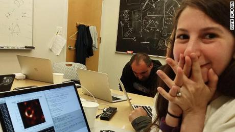 Katie Bouman with the fully-rendered black hole image.