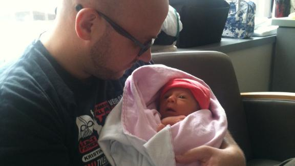 Eric Lohman holds Rosie in the hospital in August, 2012 - within a week of her birth - while awaiting a diagnosis.