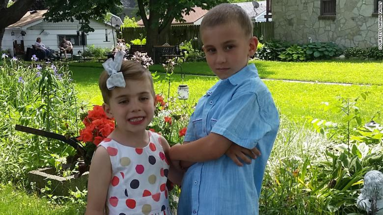 Rosie Lohman, left, poses with her brother in 2017. Rosie has been raised as a girl, but her parents refer to her as intersex and encourage gender fluidity.