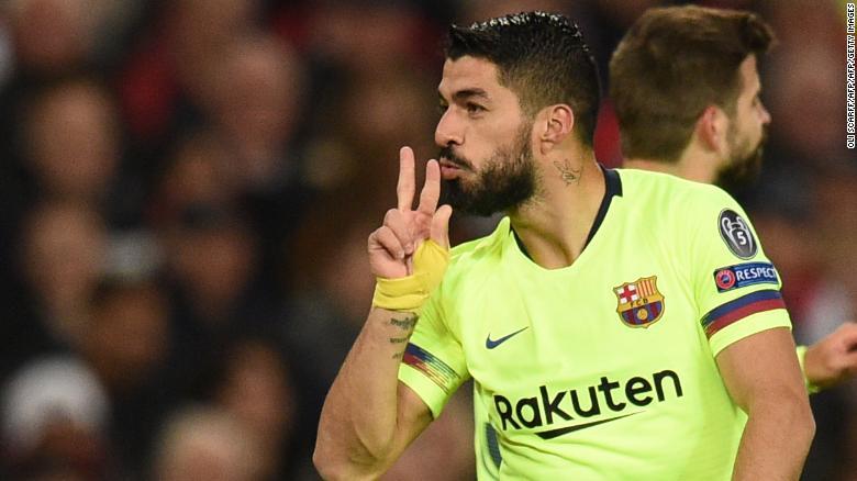 98785610a Luis Suarez celebrates after Barcelona open the scoring against Manchester  United.