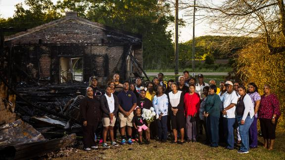 Members of the Greater Union Baptist Church stand for a portrait in front of the ruins of their church in Opelousas, Louisiana, on April 10.