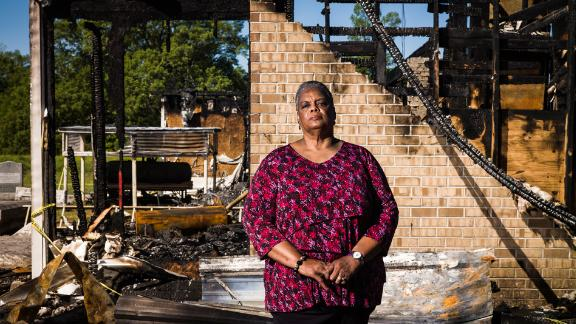 Celina G. Richard, 69, of Opelousas, Louisiana, stands for a portrait outside of the remains of the Greater Union Baptist Church in Opelousas on April 10, 2019. Richard has been a member of the church for 53 years.