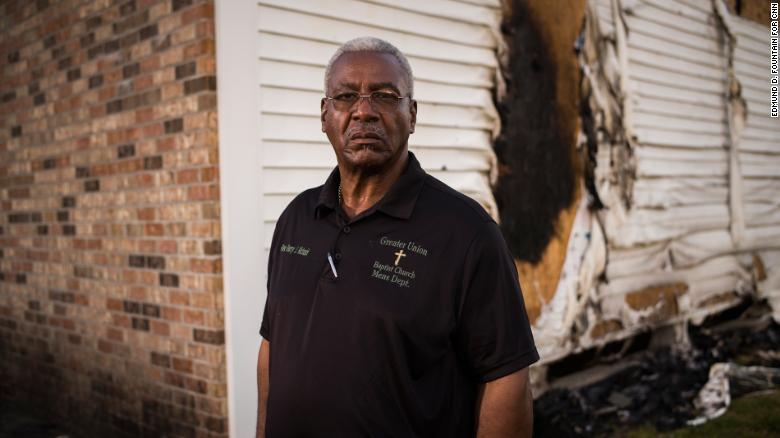 Greater Union Baptist Church Pastor Harry Richard stands for a portrait in front of the ruins of his church building in Opelousas, Louisiana.