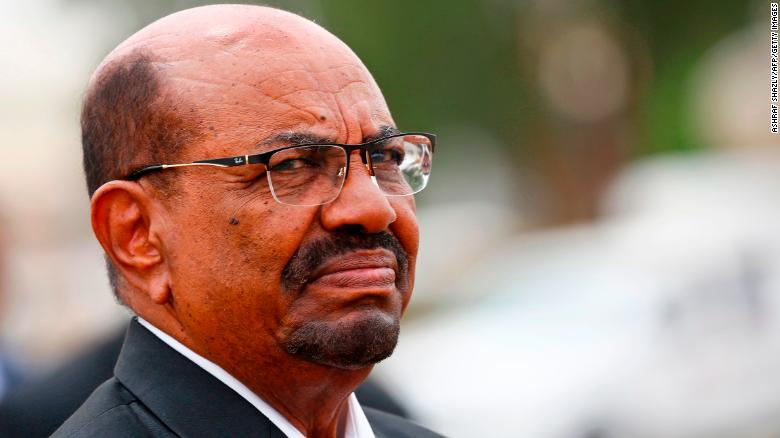 Sudan's President Omar al-Bashir looks on as he receives his Egyptian counterpart at Khartoum International Airport outside the Sudanese capital on October 25, 2018.