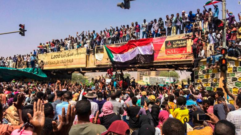 Image result for sudanese take to the street celebrating the downfall of sudan president bashir