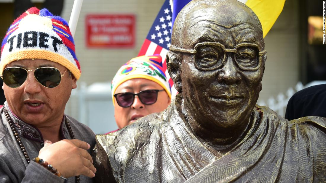 A scuplture of the Dalai Lama, by artist Chen Weiming, is unveiled in Los Angeles during a protest in front of the Consulate General of China in March 2019.