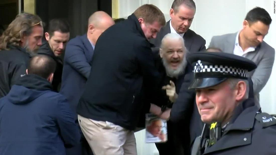 "A screen grab from video footage shows the dramatic moment when Assange was <a href=""https://edition.cnn.com/2019/04/11/uk/julian-assange-arrested-gbr-intl/index.html"" target=""_blank"">hauled out of the Ecuadorian Embassy by police</a> on Thursday, April 11. Assange was arrested for ""failing to surrender to the court"" over a warrant issued in 2012. Officers made the initial move to detain Arrange after Ecuador withdrew his asylum and invited authorities into the embassy, citing the Australian's bad behavior."