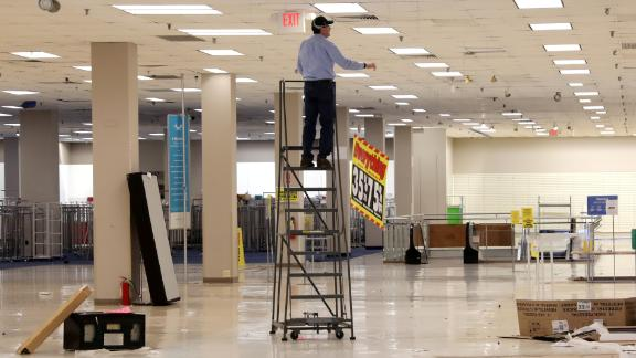 A worker removes sale banners inside a closed Sears department store one day after it closed as part of multiple store closures by Sears Holdings Corp in the United States in Nanuet, New York, U.S., January 7, 2019. REUTERS/Mike Segar