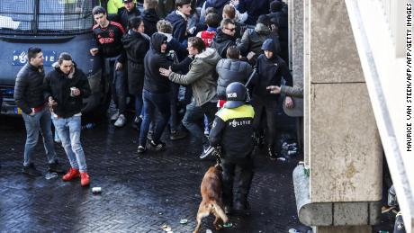 Dutch police officers surround Ajax's supporters ahead of the match.
