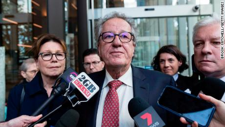 SYDNEY, AUSTRALIA - APRIL 11: Geoffrey Rush speaks to the media outside the Supreme Court of New South Wales after being awarded AUD$850,000 damages on April 11, 2019 in Sydney, Australia. The three-week defamation trial concluded in November 2018. Justice Michael Wigney today ruled in favour of Geoffrey Rush, and is entitled to aggravated damages. Rush sued The Daily Telegraph for defamation over a series of articles that were published in late November and early December 2017 that alleged he behaved inappropriate during a 2015 stage production of King Lear. (Photo by Brook Mitchell/Getty Images)