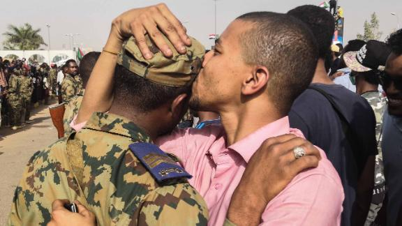 A protester kisses a soldier on the head during a rally in Khartoum on April 11.