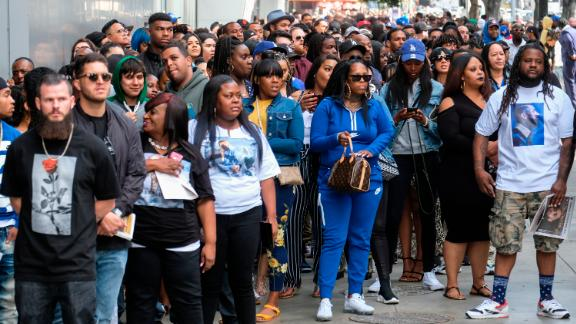 Fans of rapper Nipsey Hussle wait in line to attend a public memorial at Staples Center on Thursday.