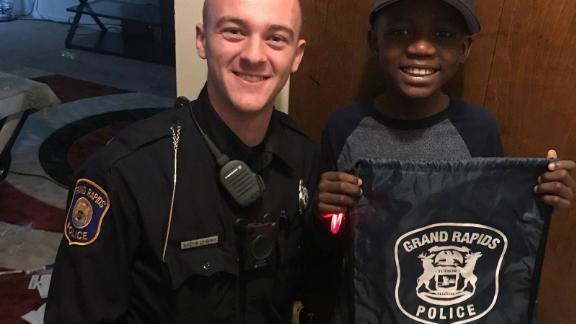 Officer Austin Lynema and Thomas Daniel.
