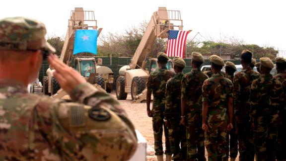 Somali national army soldiers stand in formation during a logistics course graduation ceremony. Soldiers from Somali's advanced infantry DANAB battalion spent 14 weeks training with the U.S. 10th Mountain division on the importance of logistical operation as well as the operation and maintenance of heavy equipment.  (Photo by MC2 (SW/AW) Evan Parker. Released)