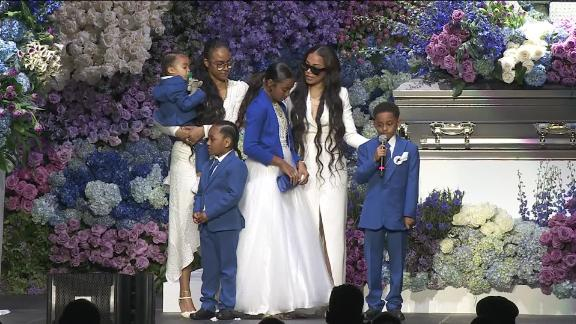 Family members and girlfriend Lauren London, second from right, paid tribute to the rapper.