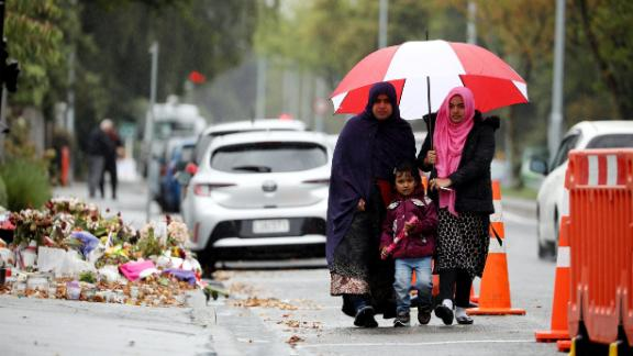 Members of the Muslim community arrive for Friday prayers at al Noor mosque in Christchurch on April 5, 2019.
