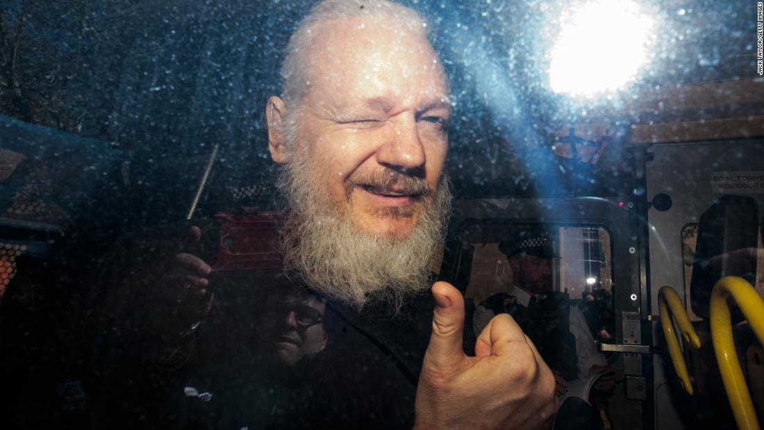 WikiLeaks founder Julian Assange gestures to the media after arriving at a court in London on Thursday, April 11. Earlier in the day, police entered the Ecuadorian Embassy to detain Assange, who had been holed up at the embassy for the last seven years.