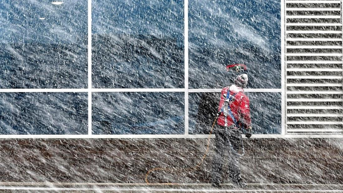"Xavier Castillo cleans windows on the Profinium building in Mankato, Minnesota, on Tuesday, April 10. A powerful ""bomb cyclone"" is whipping the central United States for the second time in four weeks, dropping snow that is making travel miserable from Colorado to Minnesota."