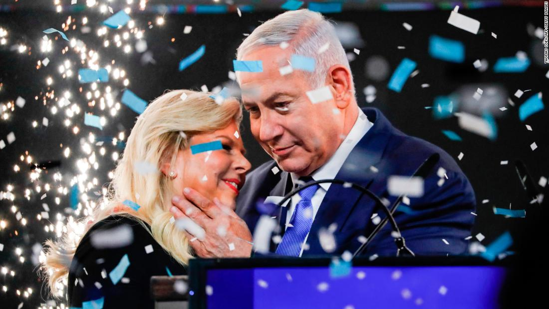 Israeli Prime Minister Benjamin Netanyahu embraces his wife, Sara, during an election-night event in Tel Aviv. Netanyahu was on course to secure a record fifth term after his main election rival conceded defeat on Wednesday, April 10.