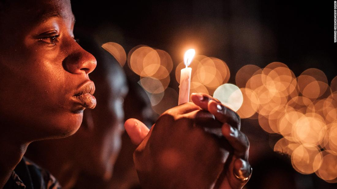 A person holds a candle during a vigil at the Amahoro Stadium in Kigali, Rwanda, on Sunday, April 7. This year marks the 25th anniversary of the Rwandan genocide, which left an estimated 800,000 people dead.