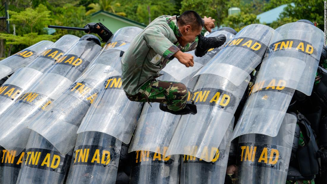 Indonesian soldiers practice riot control at a military base in Banda Aceh on Tuesday, April 9.