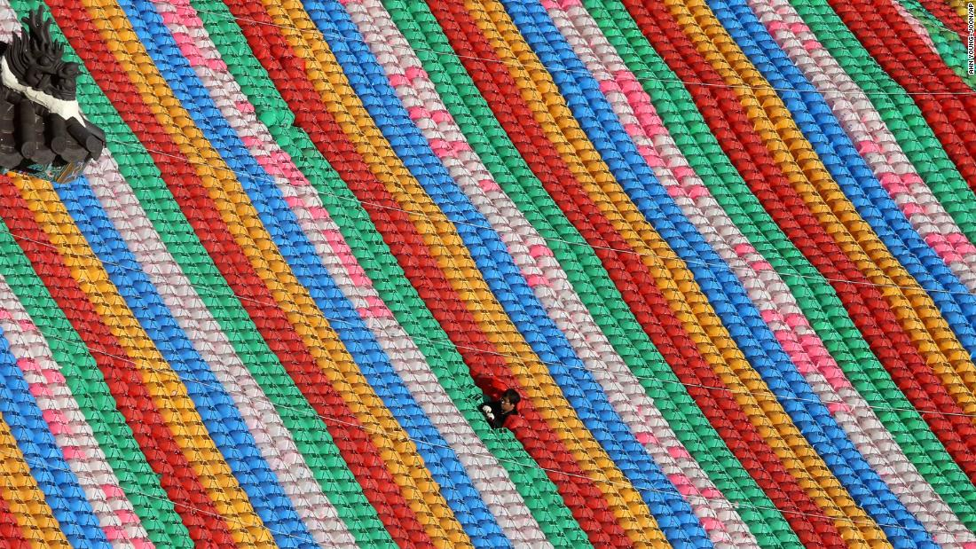 In preparation for the upcoming celebration of Buddha's birthday, a worker adjusts lanterns at the Jogye temple in Seoul, South Korea, on Monday, April 8.