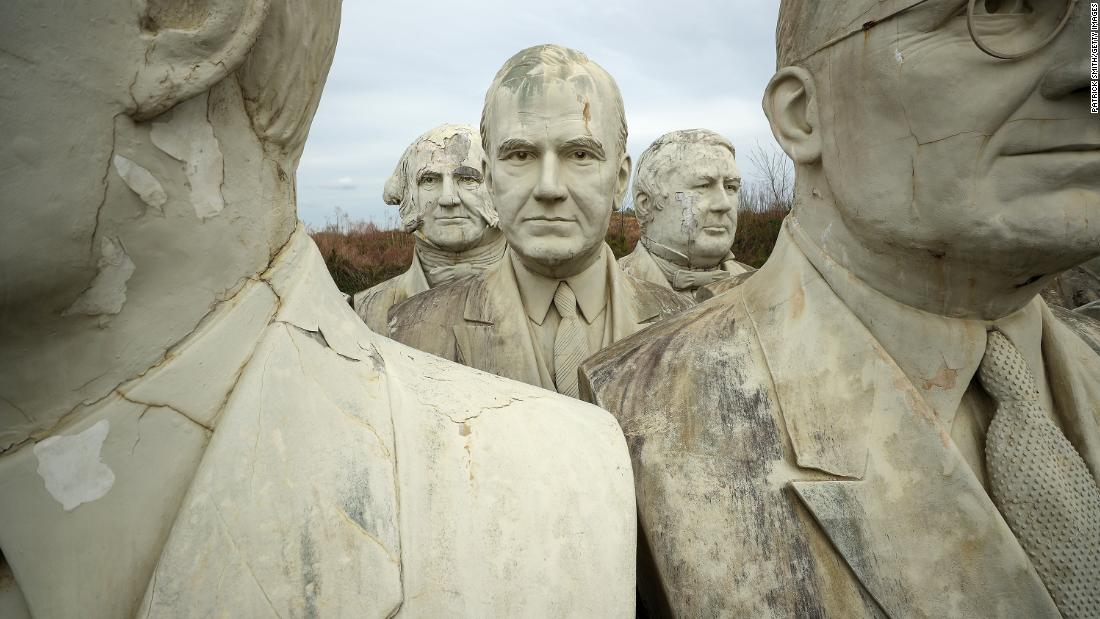 Massive sculptures of past US Presidents are stored on Howard Hankins' property in Croaker, Virginia, on Tuesday, April 9. The busts used to be part of Presidents Park, a tourist attraction that closed in 2010.