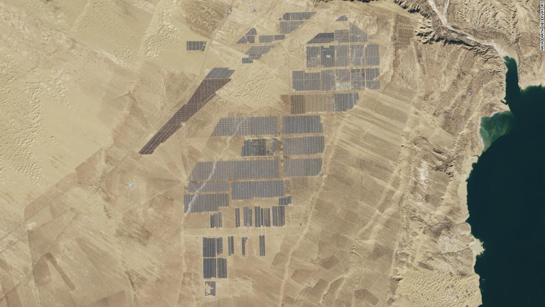 "Captured by <a href=""https://earthobservatory.nasa.gov/images/89668/longyangxia-dam-solar-park"" target=""_blank"">NASA's Landsat 8 satellite</a> in January 2017, the Longyangxia Dam Solar Park in Qinghai province has a capacity of 850 megawatts. At the time the site had a reported <a href=""https://www.climatecentral.org/news/china-solar-farm-satellite-21182"" target=""_blank"">4 million solar panels</a>, part of a wider effort by China to produce 110 gigawatts of solar power by 2020.<br />"