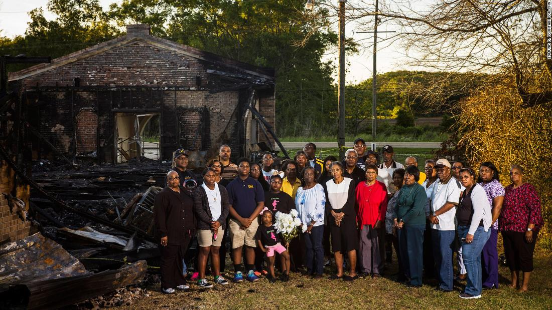 Members of the Greater Union Baptist Church stand in front of their church's ruins in Opelousas, Louisiana, on Wednesday, April 10. It was one of three historically black churches that police say were intentionally torched over a 10-day span.