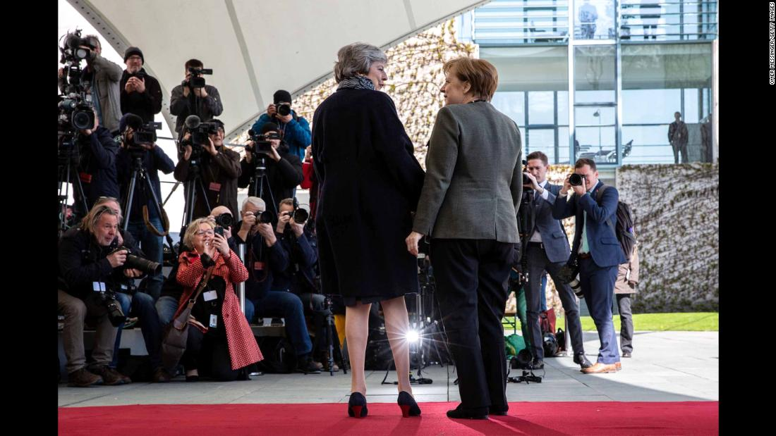German Chancellor Angela Merkel, right, greets British Prime Minister Theresa May in Berlin on Tuesday, April 9. May met with Merkel and French President Emmanuel Macron to discuss the possibility of another Brexit extension.