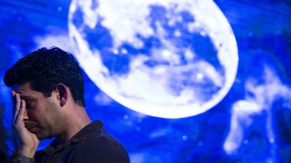TEL AVIV, ISRAEL - APRIL 11: An Israeli man react after Beresheet spacecraft fails to land safely on the moon on April 11, 2019 in Tel Aviv, Israel. The Israeli spacecraft - called Beresheet, which is a joint project between SpaceIL, a privately funded Israeli non-profit organisation, and Israel Aerospace Industries failed to land on the lunar surface after the apparent failure of its main engine. (Photo by Amir Levy/Getty Images)